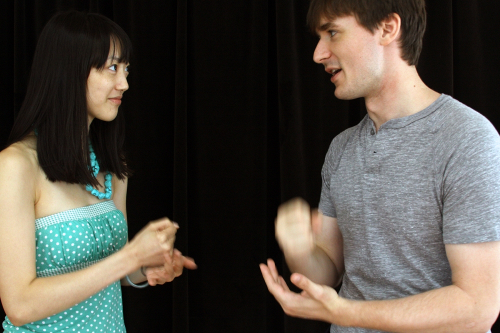Jim (Tim Dowd) and Lucy (Clara Wong) play Rock-Paper-Scissors over where to go for their honeymoon in The Photo Album.