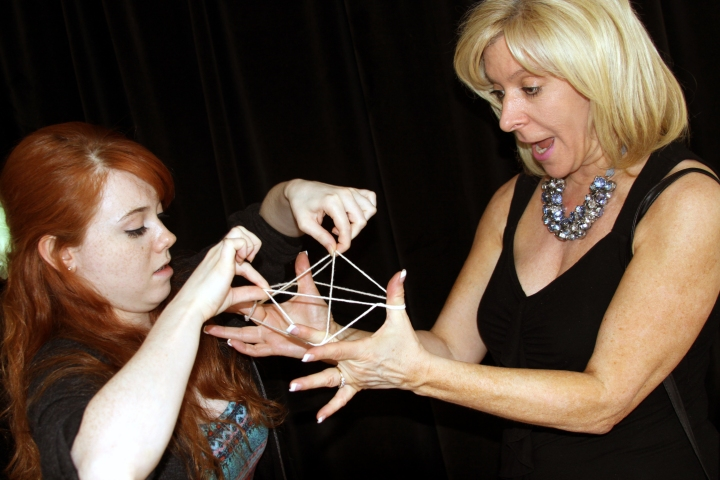 Ann (Donna Ross) and daughter Alisa (Anna Paratore) play Cat's Cradle in The Photo Album.